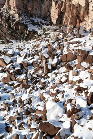 covered in snow: Background from stones covered snow Stock Photo