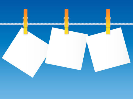 clothespeg: Blank paper on a clothes line against the blue sky