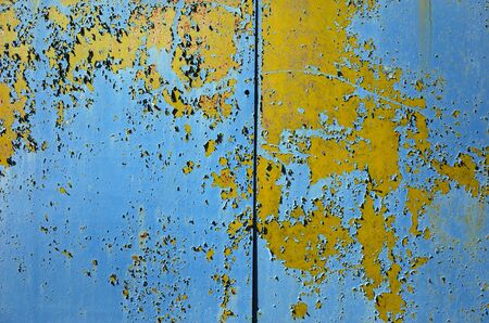 Old grunge colorful shabby metallic wall texture divided by line into two parts Banco de Imagens