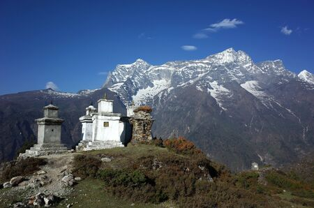 Buddhist stupas in Himalaya mountains with view of Kongde mount, Sagarmatha national park, Khumbu valley, Nepal