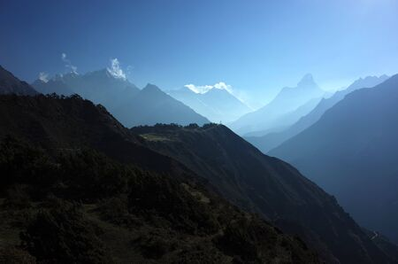 Himalayas landscape, Layers of mountains in morning mist with Ama Dablam, Everest, Lhotse silhouette. Sagarmatha national park, Khumbu valley, Himalayas 版權商用圖片