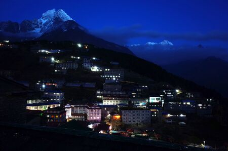 Night view of Namche Bazaar village and Thamserku mountain, Sagarmatha national park, Khumbu valley, Himalayas, Nepal