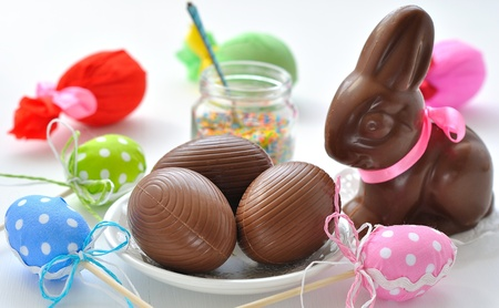 easter sunday:  Easter Bunny and chocolate eggs Stock Photo