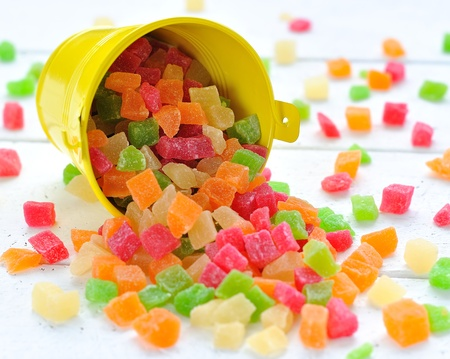 candied:  Colorful candied fruits in a small bucket