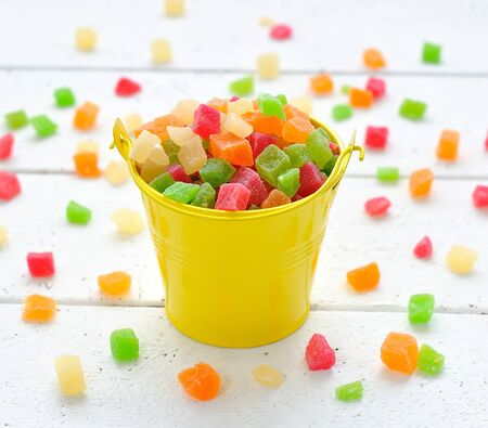 colourful candy:  Colorful candied fruits in a small bucket