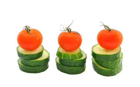 Cucumber and tomato on a white background photo