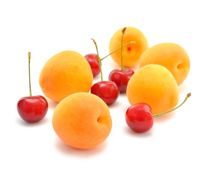 Apricots and cherries on a white background Stock Photo