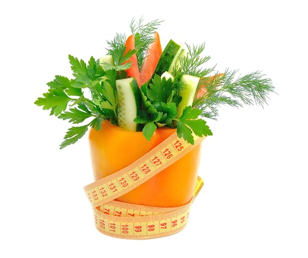 vegetables and measuring tape on white background