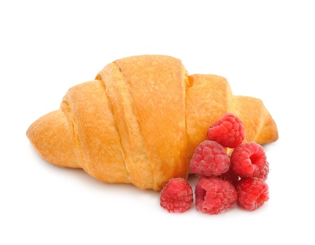 Croissant with raspberry on white background