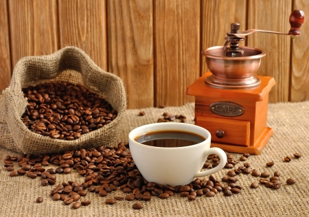 Manual coffee grinder and coffee beans photo