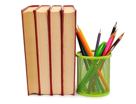 Books and pencils on a white background photo