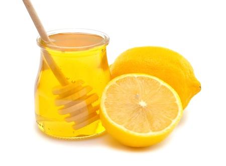 Honey and lemon on a white background