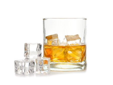 intoxicating:  Whiskey and ice isolated on white background