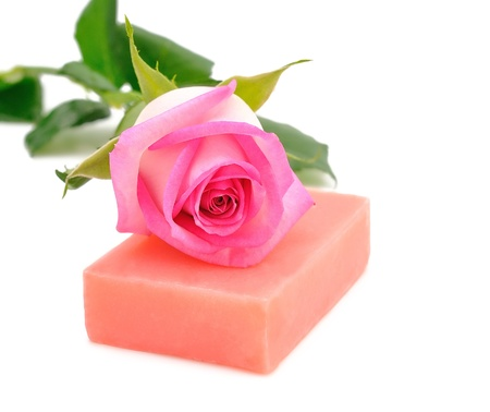 Soap and rose isolated on white background photo