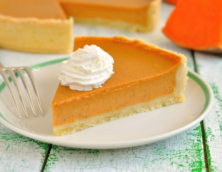 Pumpkin pie with whipped cream photo