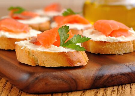 Sandwiches with a salmon on a brown table Stock Photo