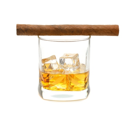 intoxicating: Whiskey and a cigar isolated on white background
