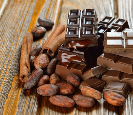 Chocolate and cocoa beans on a brown table Stock Photo - 16724476