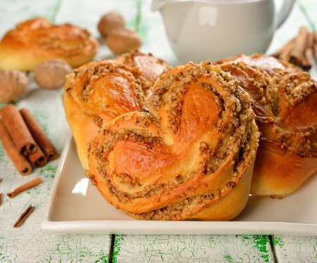 Sweet buns with nuts in the form of heart photo