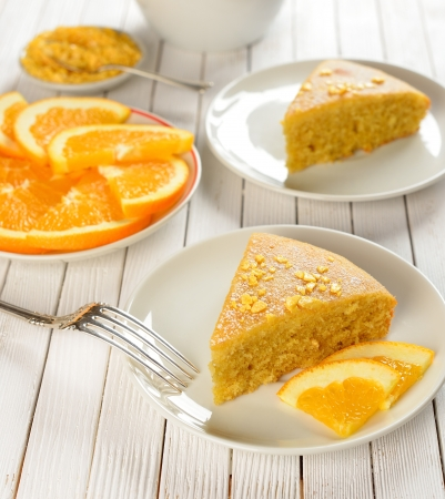 Orange cake on a white table Stock Photo