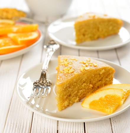 Orange cake on a white table Stock Photo - 16911012