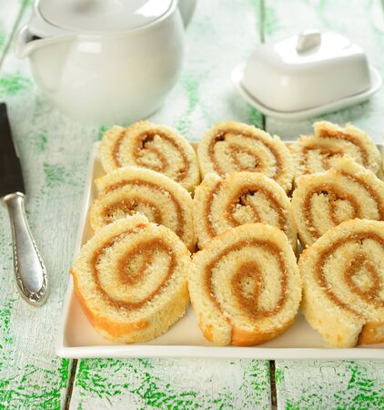 Rolls with cream on a white table Stock Photo - 16935123