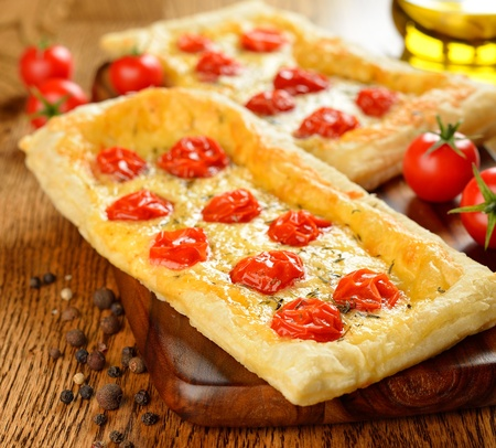 Tart with cheese and cherry tomatoes on a brown table Stock Photo - 17011103
