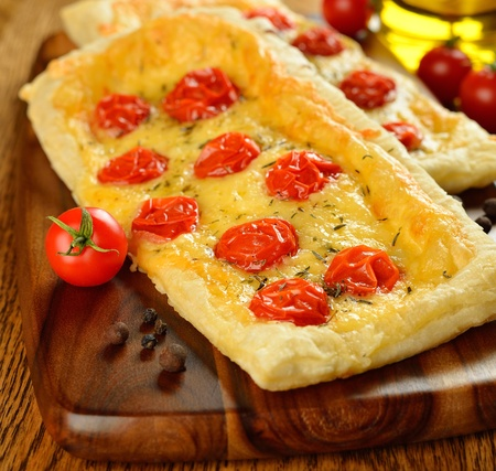 Tart with cheese and cherry tomatoes on a brown table Stock Photo - 17011098
