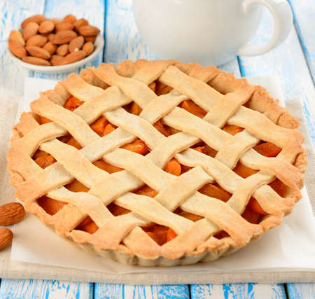 Pie with apricots on a blue table Stock Photo - 17165108