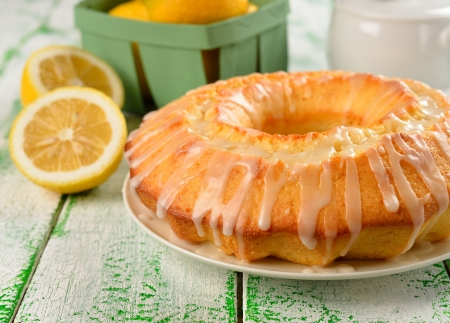 Lemon cake with frosting on a green table  Stock Photo