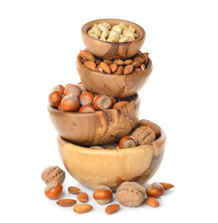 cashew nuts:  Nuts in a wooden bowl on a white background Stock Photo