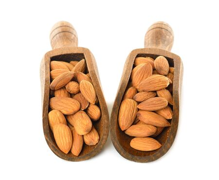 almonds in a wooden scoop on white background photo