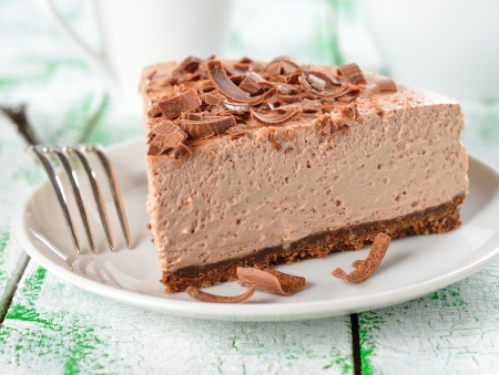 Cold chocolate cheesecake on a white plate