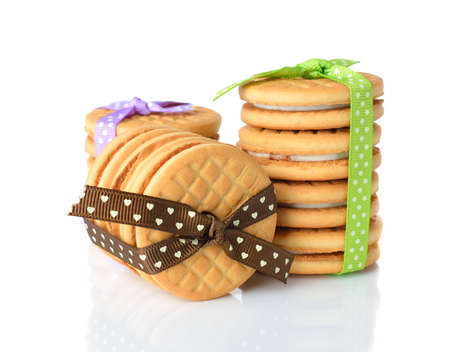 Cookies decorated with ribbons on white background Stock Photo - 18034660