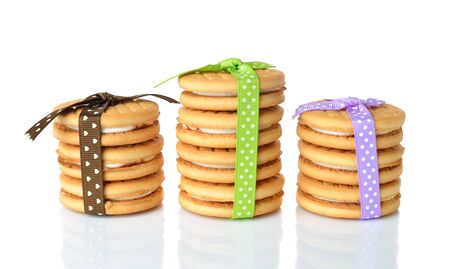 Cookies decorated with ribbons on white background Stock Photo - 18034661