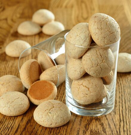 Italian amaretti cookies on a brown table photo