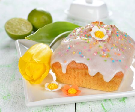 Lime cupcake decorated with glaze on a white table photo