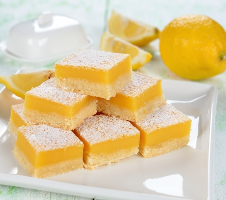 lemon cake: Traditional lemon bars on a white table