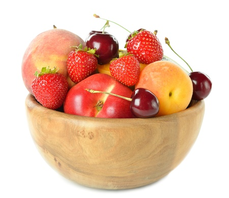 Various fruit in a wooden bowl isolated on a white background Stock Photo - 20102280