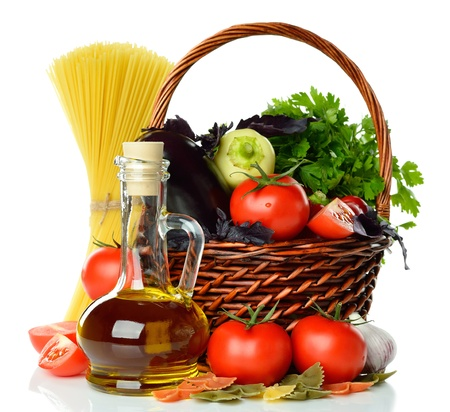 Vegetables, pasta and olive oil isolated on white background photo