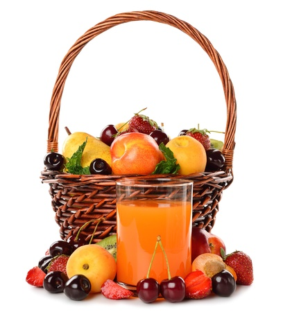 Various fruit in a brown basket and juice isolated on white background photo