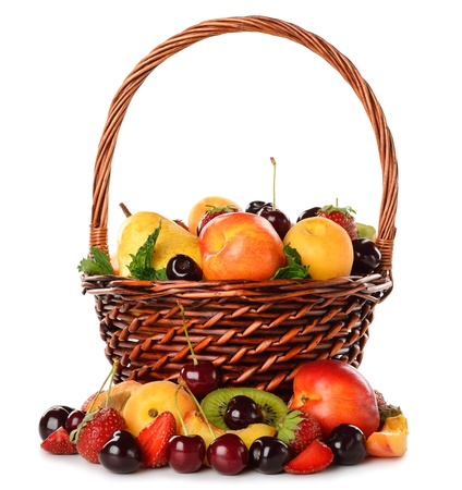 Various fruit in a brown basket  isolated on white background photo