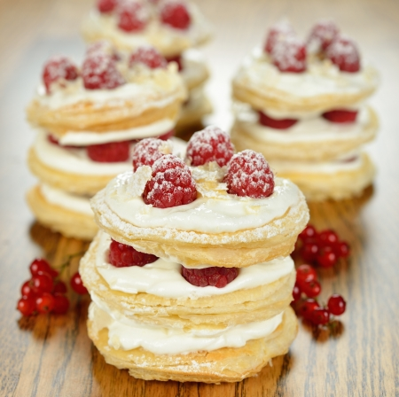 napoleon dessert: Millefeuille with raspberry  on a brown table