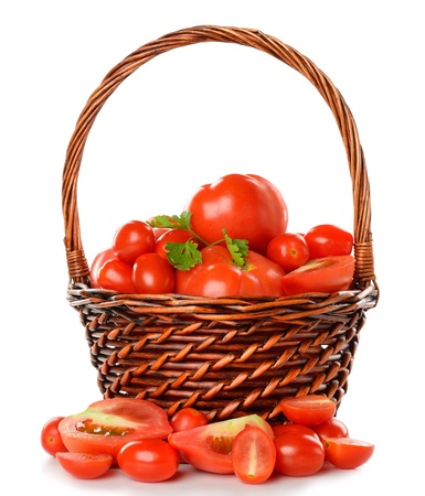 Fresh tomatoes in a basket isolated on white background photo