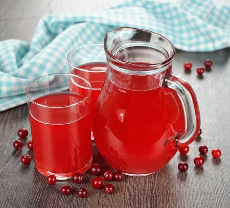 Fresh cranberry juice on a brown table Stock Photo