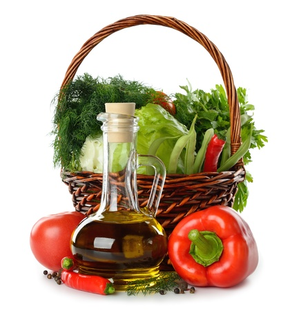 Olive oil and vegetables isolated on white background photo