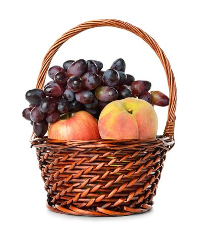 Fruits in a basket isolated on white background photo