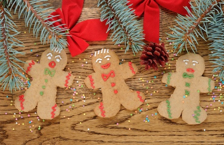 Gingerbread men on a brown background Stock Photo - 21718185