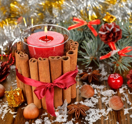 christmas candle: Christmas candle and decorations on a brown background Stock Photo