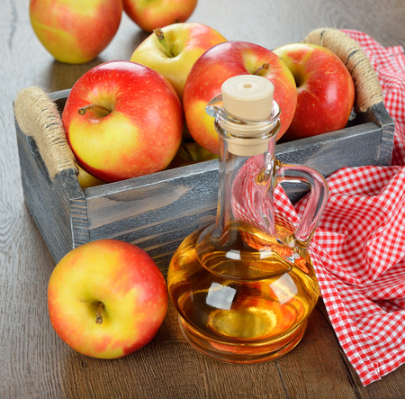 apple cider vinegar on a brown table Stock Photo